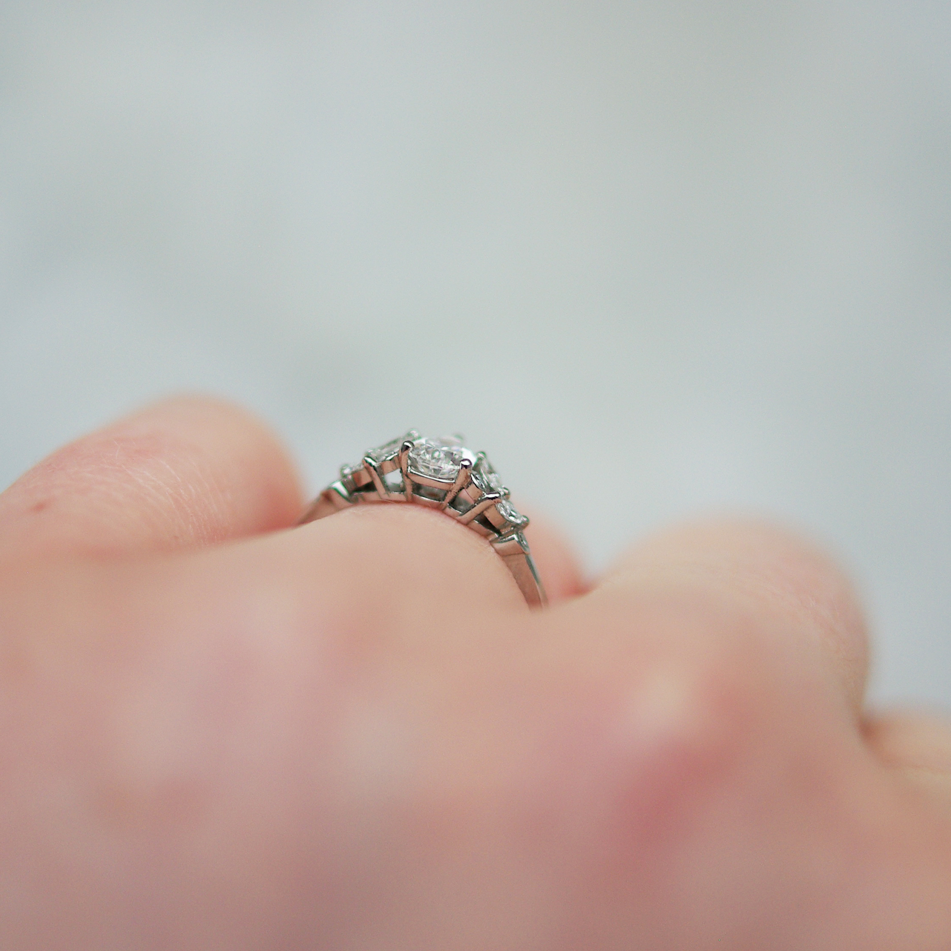 Pear Cut Diamond Engagement Ring in Platinum With Marquise And Round Shoulders