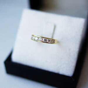Channel Set Seven Diamonds Eternity Ring