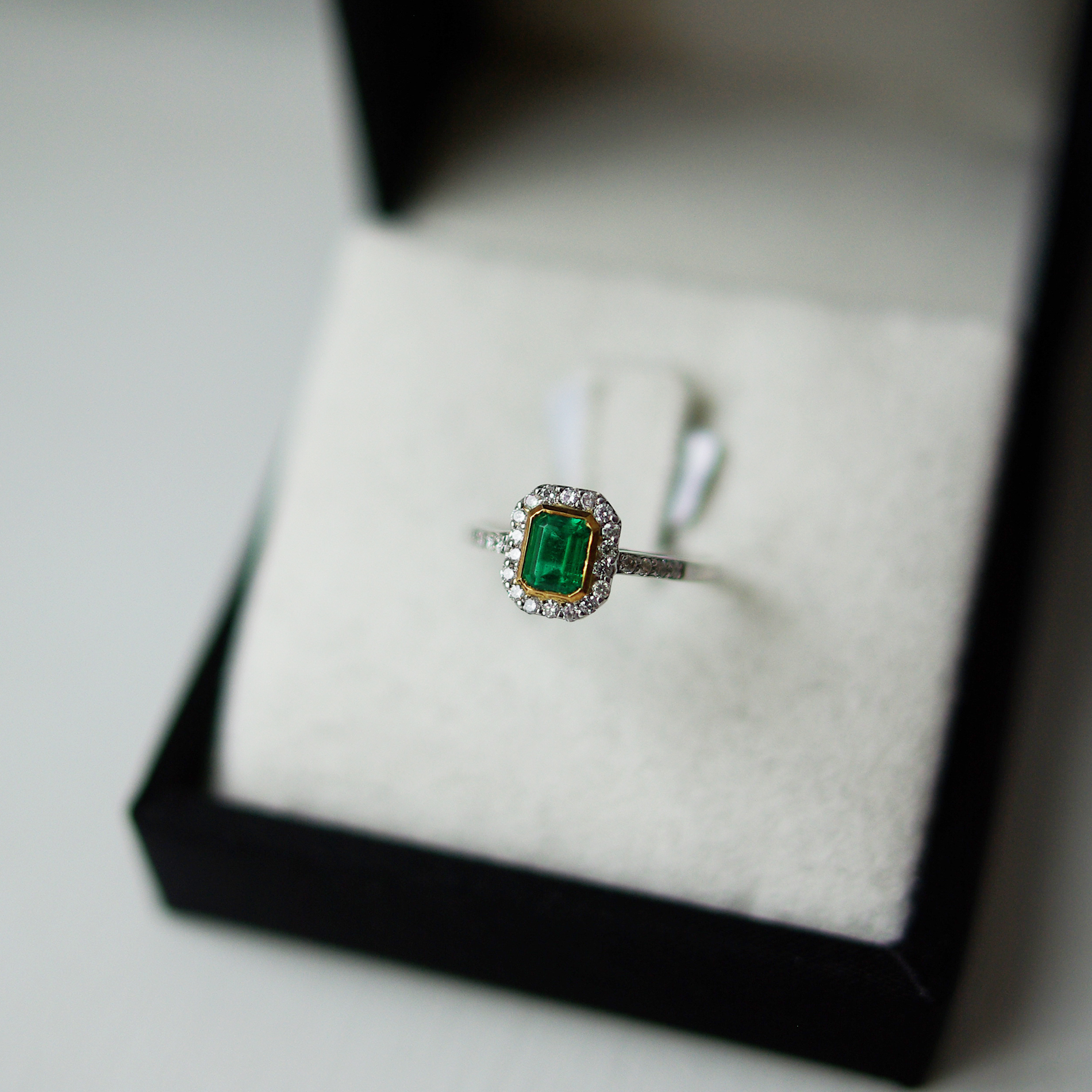 Emerald Cut Emerald Channel Pave Halo And Shoulders