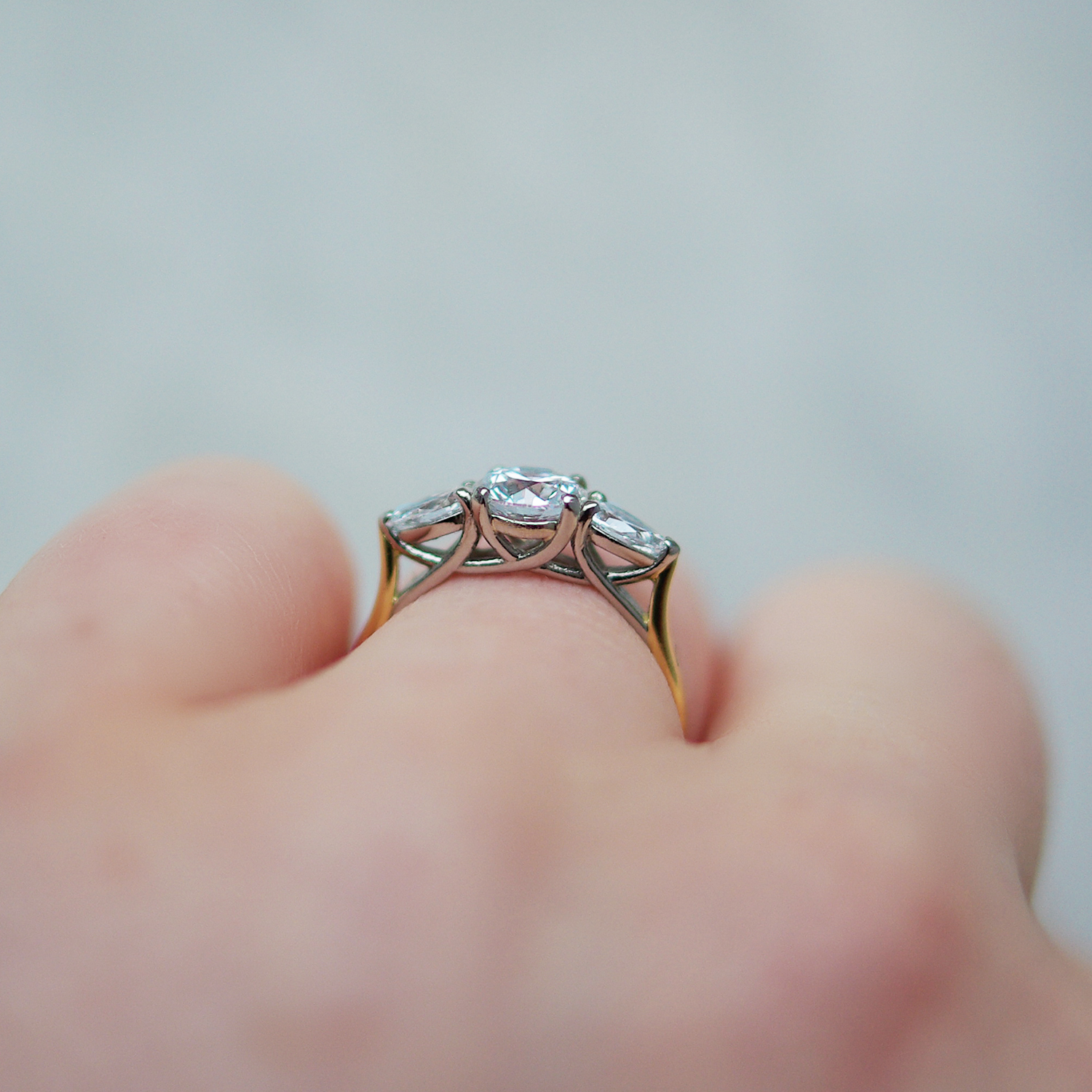 Trilogy Engagement Ring With a Round Brilliant Cut Diamond And Pear Cut Diamond Outers