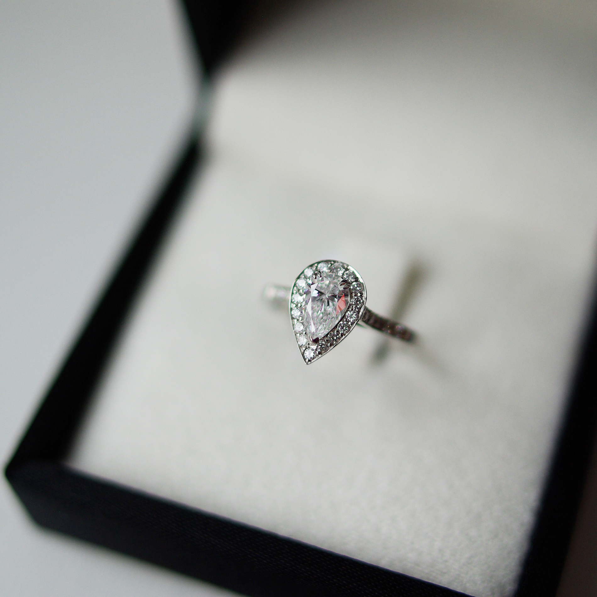 Pear Cut Diamond Channel Pave Halo And Diamond Shoulders Engagement Ring