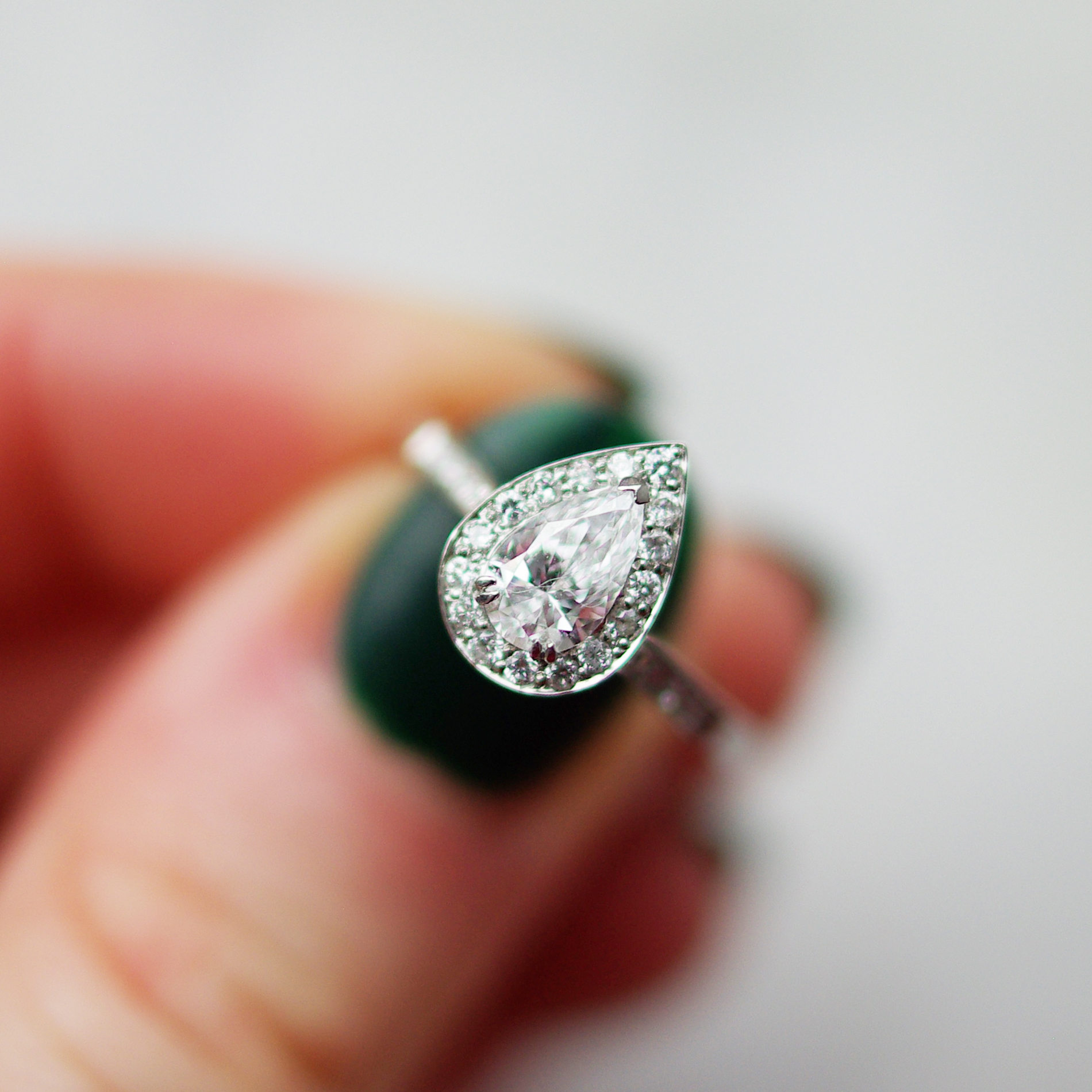 Pear Cut Diamond Channel Pave Halo And Diamond Shoulders