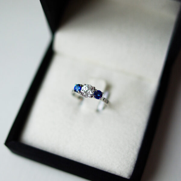 Trilogy Engagement Ring With Two Round Brilliant Cut Sapphires And a Meteor Cut Diamond