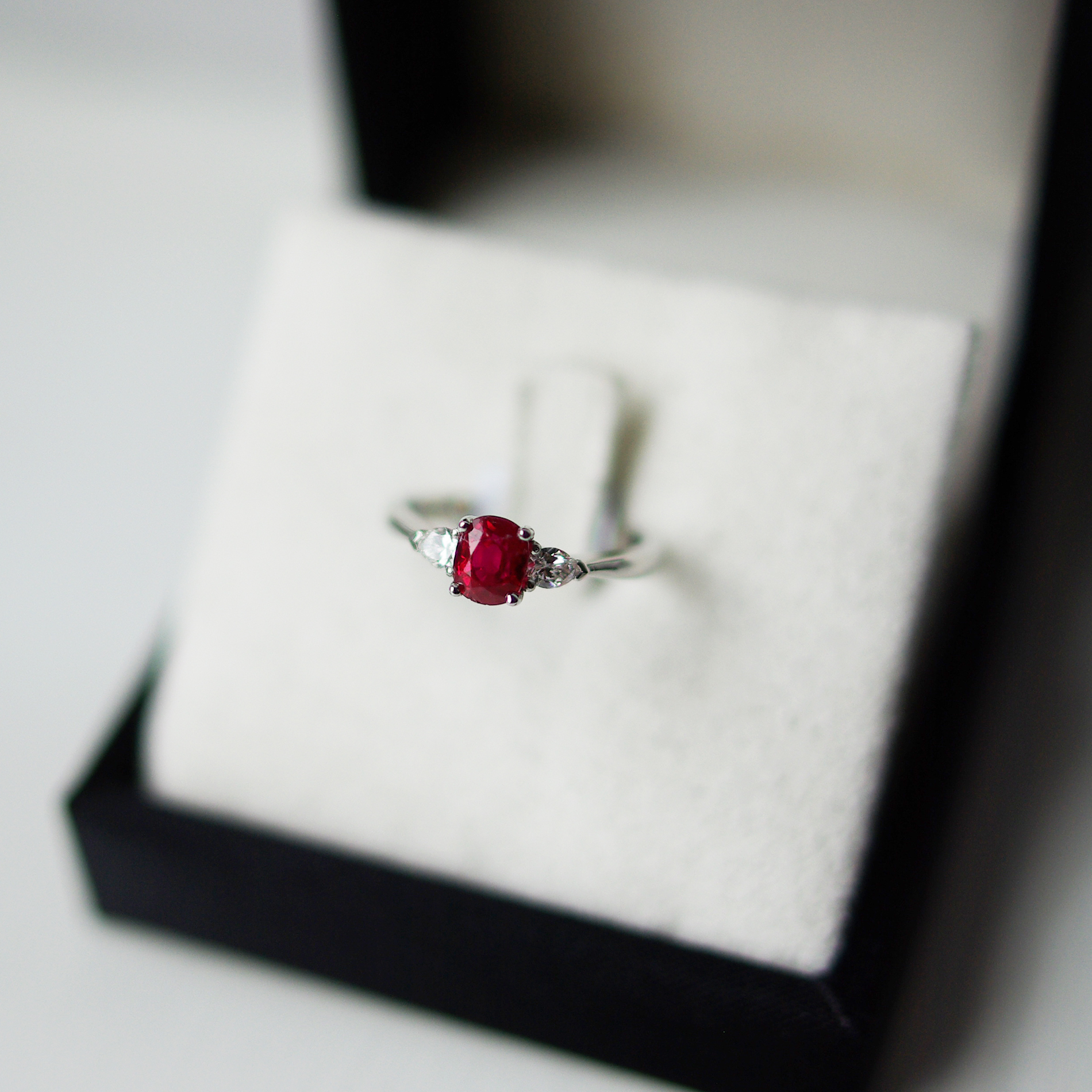 Oval Ruby Four Claw Setting Pear Cut Diamond Outers Trilogy Ring In Platinum