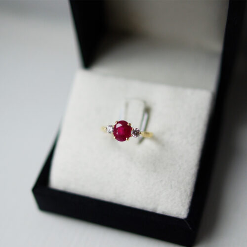 Oval Ruby With Round Brilliant Cut Diamond Outers Trilogy Ring