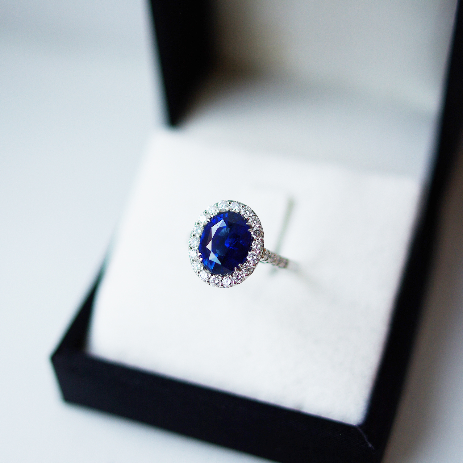 Oval Sapphire Cluster Ring With Diamond Set Shoulders