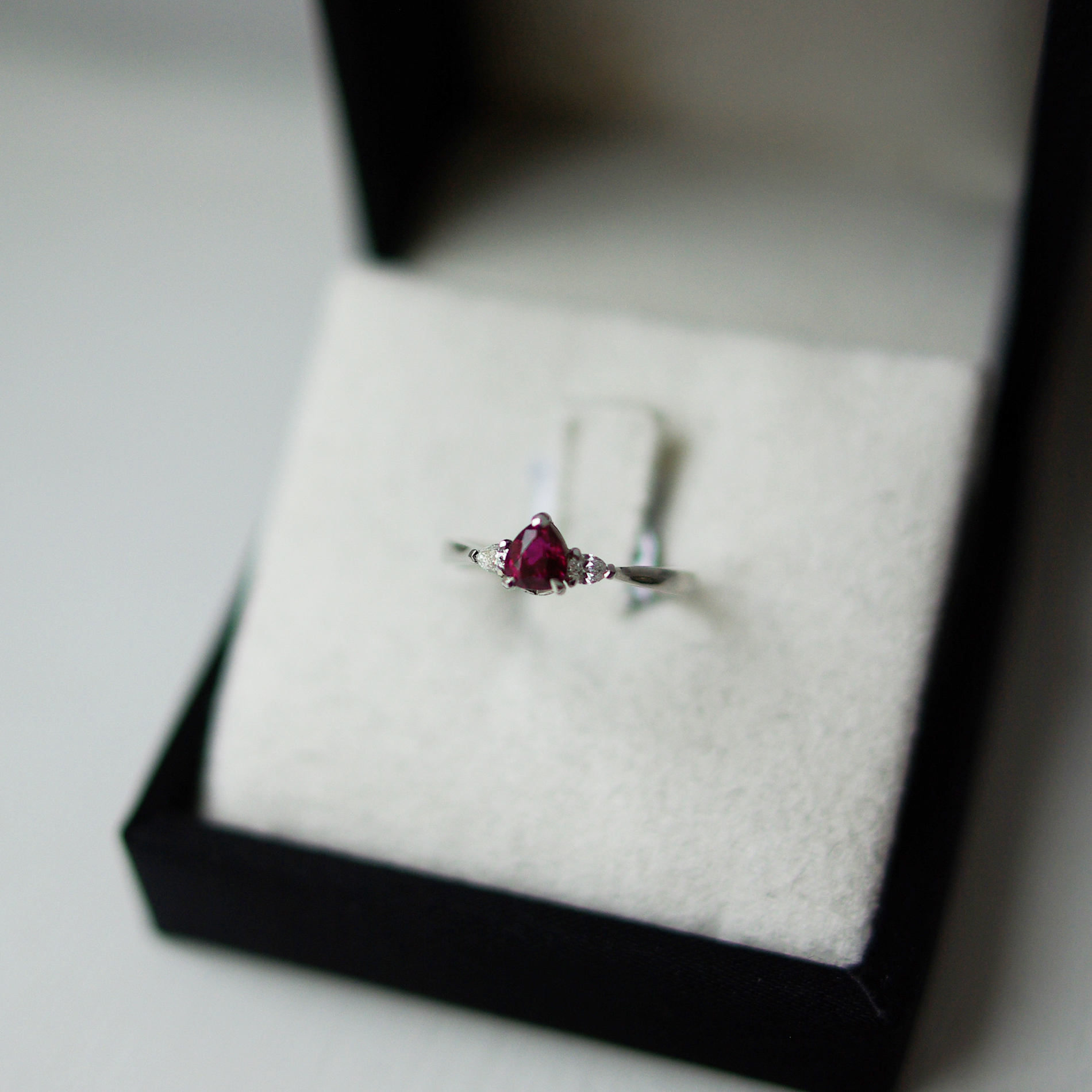 Pear Cut Ruby With Pear Cut Diamond Outers Trilogy Ring