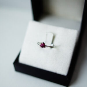 Pear Cut Ruby And Pear Diamond Outers Trilogy Ring