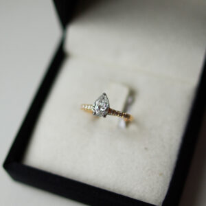 Pear Diamond And Diamond Set Shoulders in Yellow Gold And Platinum