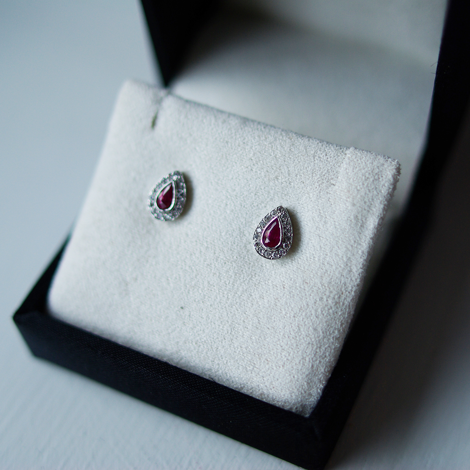 Pear Ruby And Diamond Halo Studs