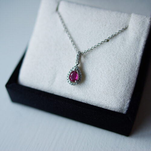 Pear Ruby With Halo And Diamond Bail