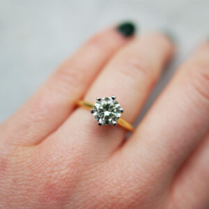 Six Claw Round Brilliant Cut Engagement Ring In Yellow Gold And Platinum