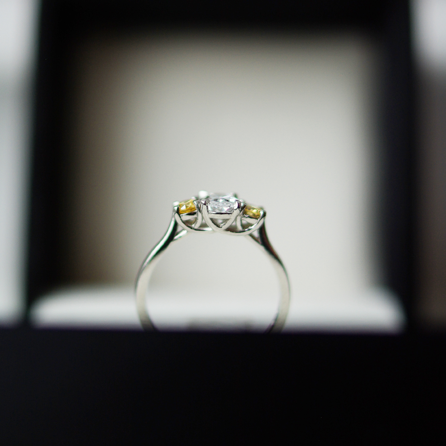 Trilogy Engagement Ring With Two Round Brilliant Cut Yellow Diamonds And A Colourless Oval Cut Diamond